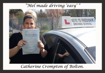 Catherine Crompton poses with her certificate after passing her driving test with Keys to Freedom Driving School Bolton.